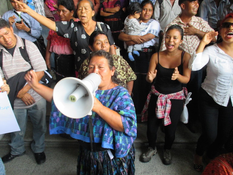 A woman led a crowed in chants demanding President Otto Pérez Molina's resignation. The crowd was gathered right next to the gates of the National Palace in Guatemala City on May 20. Photo by Sandra Cuffe.
