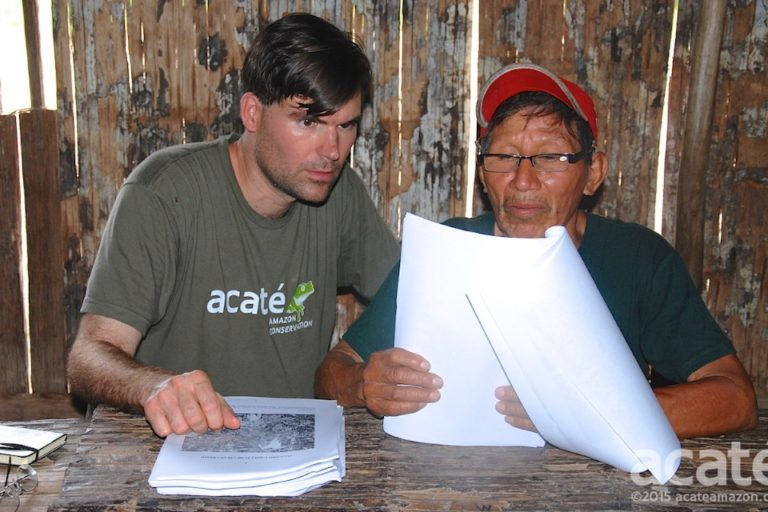 Chris Herndon (left) and Arturo, a shaman (right), look over drafts of the new encyclopedia. Photo courtesy of Acaté