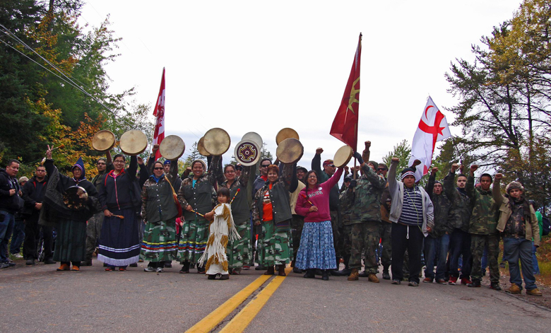 Protestors demonstrate against a company exploring for fracking opportunities near the Elsipogtog First Nation in New Brunswick. Police raided the protest camp in October 2013, arresting 40. Photo credit: Belinda Levi.