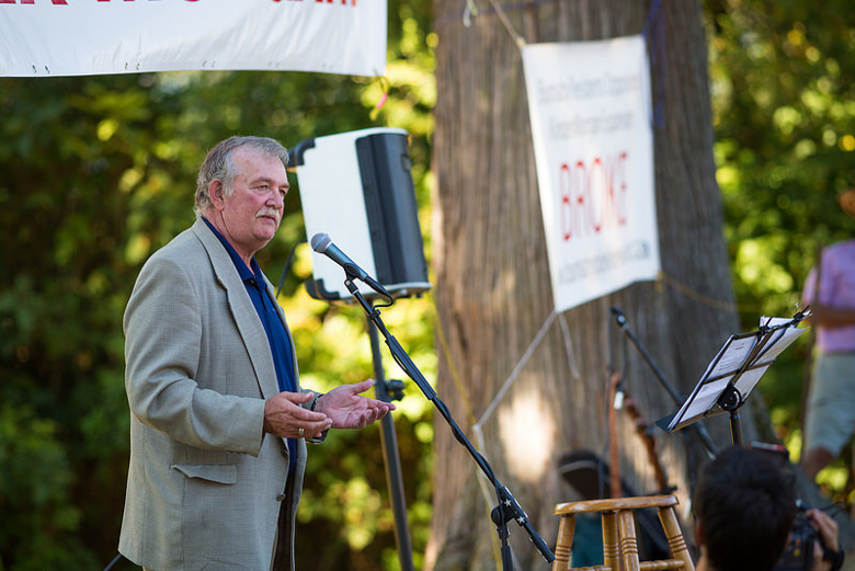 Derek Corrigan, mayor of Burnaby, British Columbia, addresses a crowd protesting a pipeline planned to run under the Burnaby Mountain protected area, in September, 2014. Photo credit: Mark Klotz.