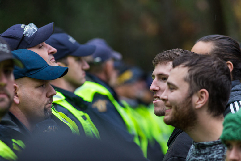 Police meet protesters at a rally against a pipeline on Burnaby Mountain, British Columbia, in November, 2014. Photo credit: Mark Klotz.