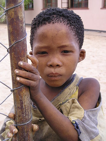 San boy in New Xade, a resettlement camp for people expelled from the Central Kalahari Game Reserve. Photo credit: Public domain via Wikipedia.