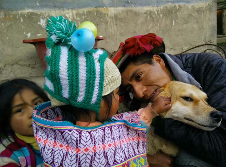 Yupanqui, his baby daughter Hilda, and Princesa, their long-suffering retriever. Credit: Saul Elbein