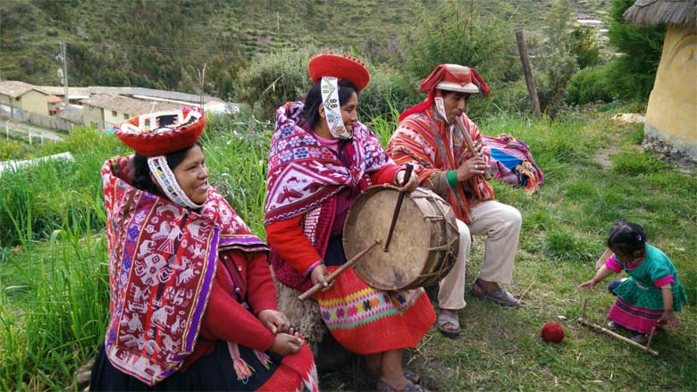 Yupanqui, his wife Elena and a neighbor warming up for a tourist visit. Credit: Saul Elbein