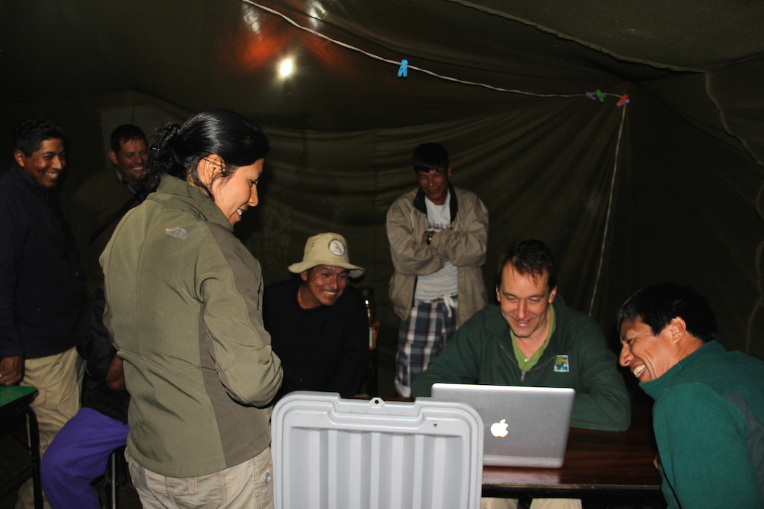 At the end of the trip, the team reviewed the camera trap footage. Photo by Morgan Erickson-Davis.