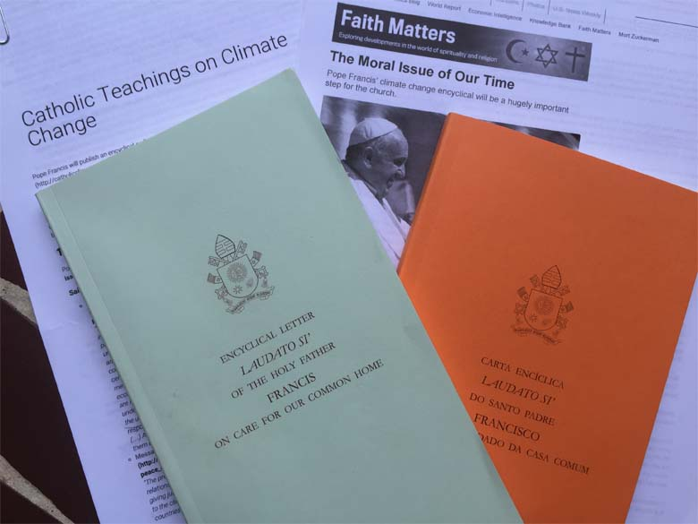 The printed version of the papal encyclical from the Vatican, offered in English and Portuguese. Photo by Justin Catanoso.