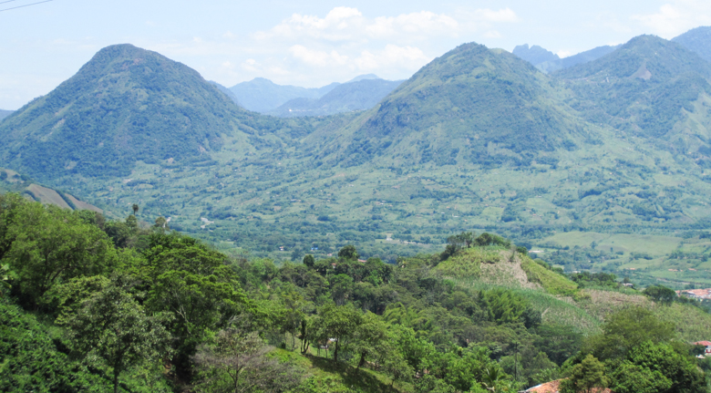 A view of mountains sacred to the Embera Chamí indigenous group on the Cañamomo Lomaprieta Indigenous Reservation. The mountains likely contain rich gold deposits and have been flown over by corporate prospectors without the consent of indigenous authorities, according to Viviane Weitzner, policy advisor with the NGO Forest Peoples Programme. Photo credit: Viviane Weitzner / Forest Peoples Programme.