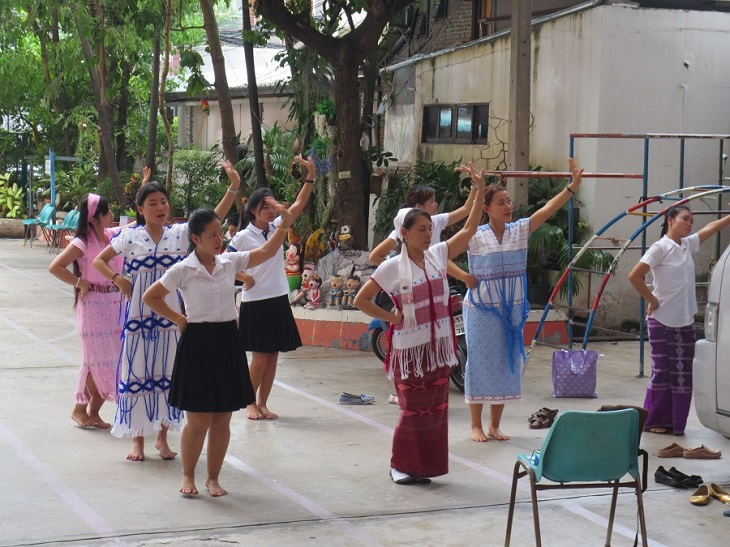 Karen girls practice a traditional dance at DEAR Burma, a nonprofit language school for migrants in central Bangkok. Photo by Sarah Hucal