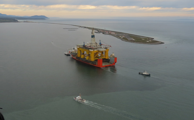 """A ship carrying Shell's drilling rig """"Polar Pioneer"""" arrives in Port Angeles, Washington, in April, en route to the Chukchi Sea. Photo courtesy of U.S. Coast Guard Air Station Port Angeles / Coast Guard News."""