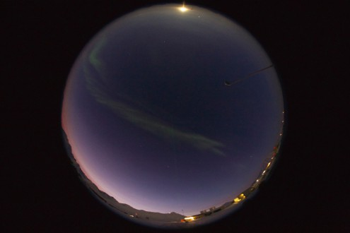 An all sky image of the noon sky in Ny-Ålesund with four sources of illumination; sun, moon, aurora borealis and artificial light. Photo by Prof Geir Johnsen (NTNU).