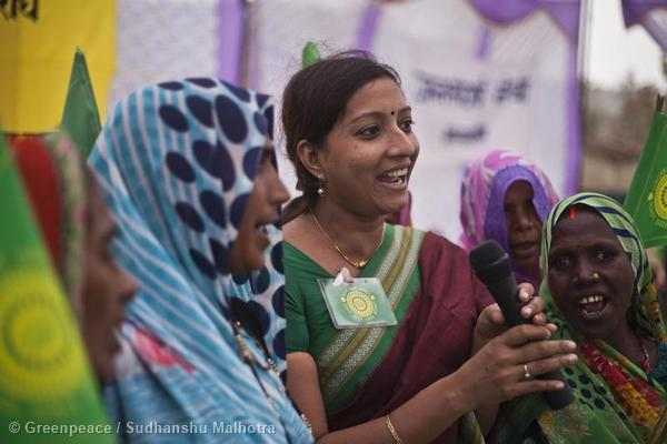 Priya Pillai, Senior Campaigner for Greenpeace India, addresses local people during celebrations for the Government's decision to stop the Mahan coal block from mining. Photo courtesy of Greenpeace.