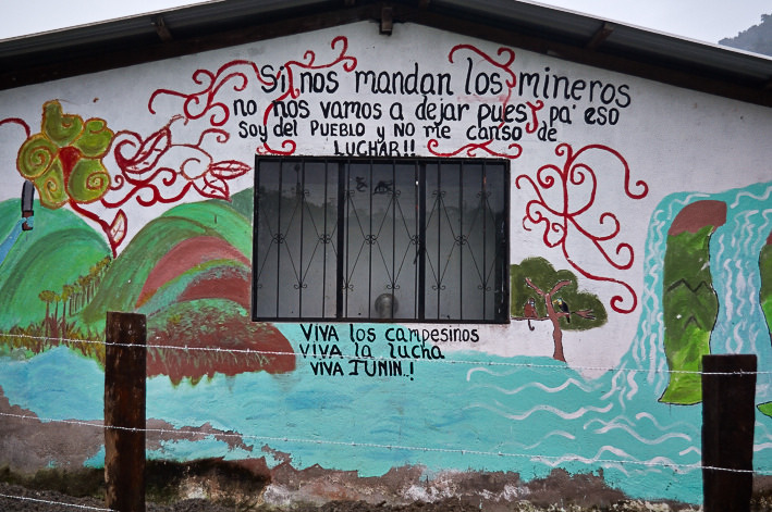 Extractive industry projects have faced fierce community opposition for years. A mural in the Intag region of Ecuador proclaims local resistance to mining. Photo by pato chavez.