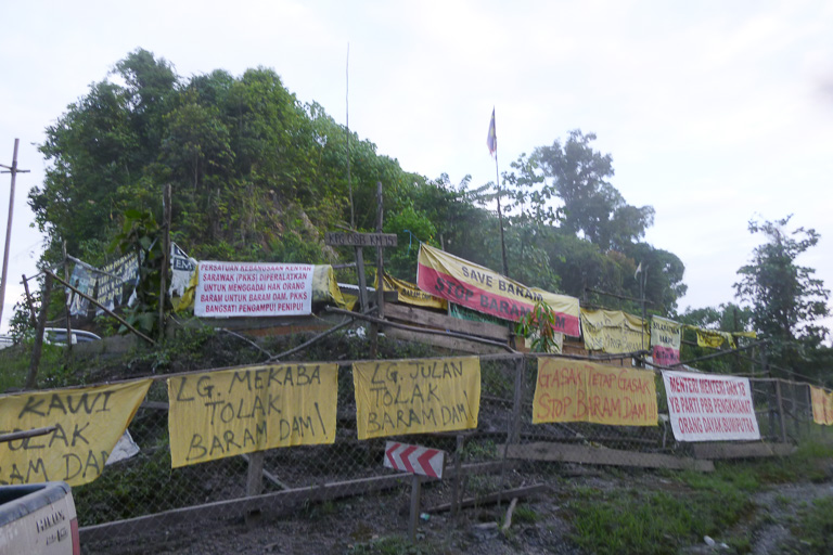 Banners outside the blockade camp at kilometer 15 of the Baram Dam access road. As part of a meeting of anti-dam activists this week, indigenous people from around the globe will join protesters at the camp. Photo courtesy of Bruno Manser Fonds.