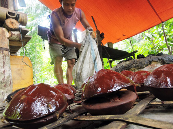Red palm sugar is prepared by farmers in Rumbia, who say their product is the region's best. Photo by Christopel Paino
