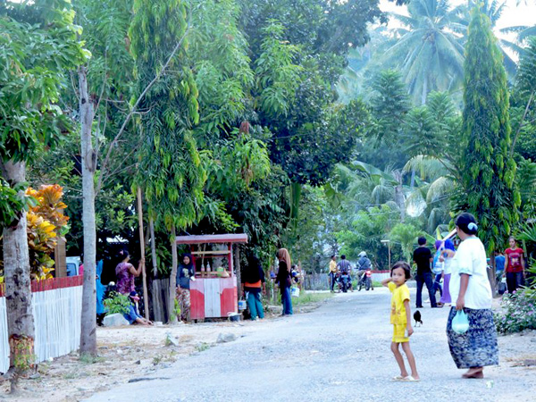 A street in Rumbia on the Indonesian island of Sulawesi. The village has turned down repeated advances from oil palm interests. Photo by Christopel Paino