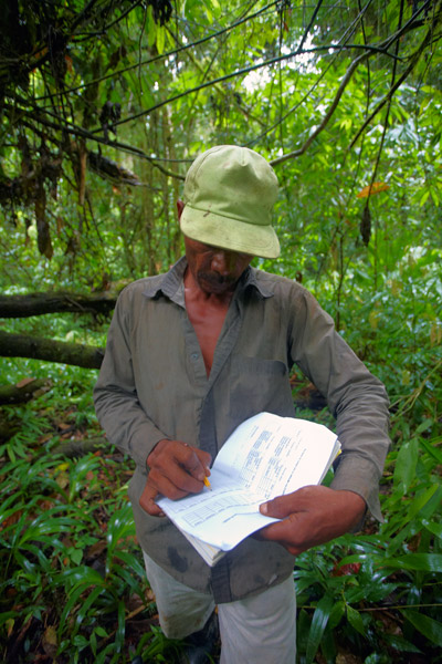 A Miskito community member recording his sightings and signs of mammals and birds during a foot patrol in Nicaragua. Photo by SUNE HOLT.