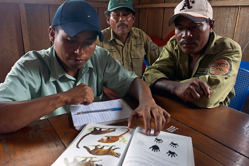 Miskito community members in Nicaragua selecting the mammal species they would like to monitor. Photo by SUNE HOLT.