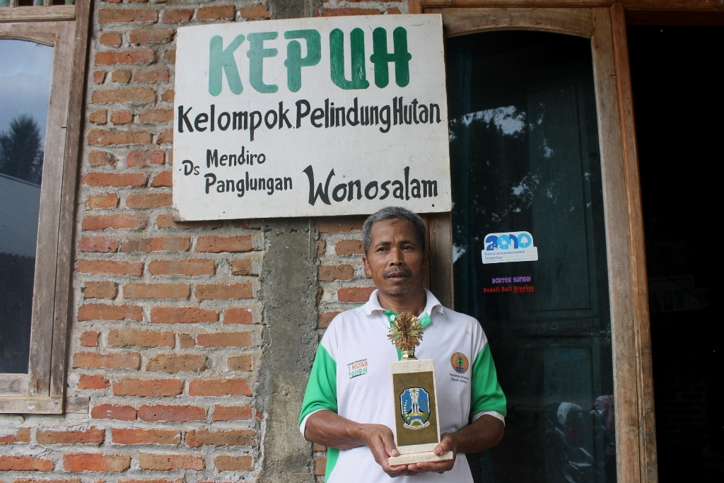 Wagisan, head of Mendiro village's Forest Protection and Water Conservation Association, or Kepuh, displays the Kalpataru prize, awarded to the organization by the Indonesian government for its work in conservation. for Photo by Petrus Riski