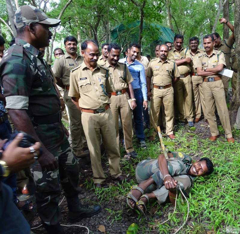 Indian law enforcement officials learn how to apprehend a suspect in the forest at a training on methods to combat wildlife crime in August. Seven or eight such trainings now take place across the country each year. Photo courtesy of TRAFFIC India.