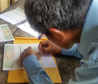 Local coffee farmer signing the agreement papers. Photo courtesy of Rainforest Trust.