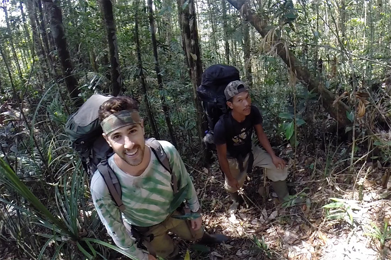 Researcher Matthew Luskin at the tail end of a three week expedition to collect camera traps from Gunung Leuser National Park. Photo courtesy of Matthew Luskin / NGS.