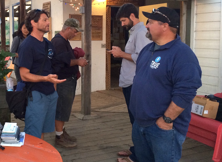 California Stranding Network Coordinator Justin Viezbicke (left) talks to crab fisherman Geoff Bettencourt (right) at a training teaching fishermen how to respond to entangled whales in Half Moon Bay, California, on October 20.