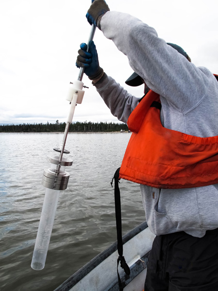 Co-author Prentiss Balcom collects sediment from the bottom of Lake Melville to help estimate how much methylmercury is produced in the ecosystem now. Photo by Amina Schartup.