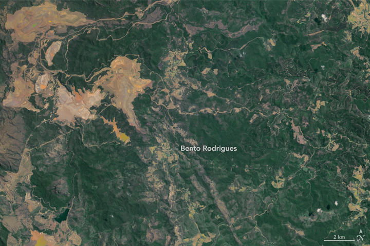 The left image shows the area on October 11, 2015; the right image shows the area on November 12, after the catastrophe. Image courtesy of NASA's Earth Observatory.