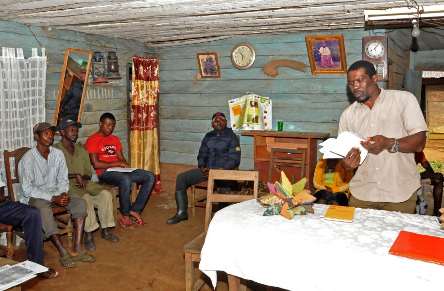 Nasako Besingi of Cameroonian NGO Sefe, addresses residents of Iwei Village during a meeting held in conjunction with Greenpeace to provide information on the implications of U.S. company Herakles Farms' plans to develop a large oil palm  plantation in a largely forested area. Photo courtesy of Greenpeace.