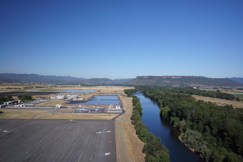 "Installing refrigerators to cool water discharged from this aging wastewater treatment plant in Medford, Oregon, would have cost millions. Instead, the City of Medford bought ""thermal credits"" to make up for the discharges that, along with a USDA grant, paid for tree planting on private land along the river to shade and cool the water. Such projects are known as ""payments for ecosystem services,"" a controversial approach to conservation that is gaining popularity. Photo courtesy of the Freshwater Trust."