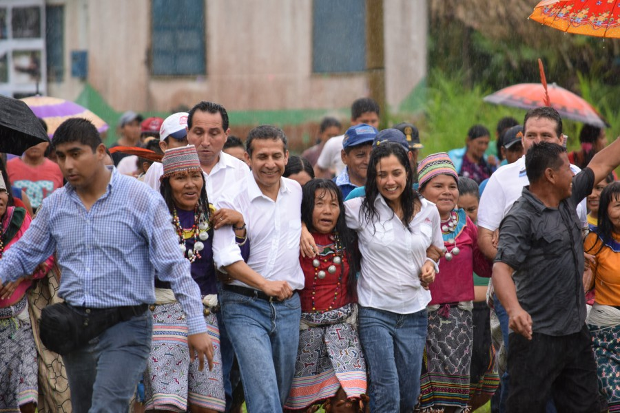 Peru's president Ollanta Humala flanked by community members make their way through the rain in Pucallpa to sign the official declaration of Sierra del Divisor National Park. Photo by Candy Vilela/CEDIA.
