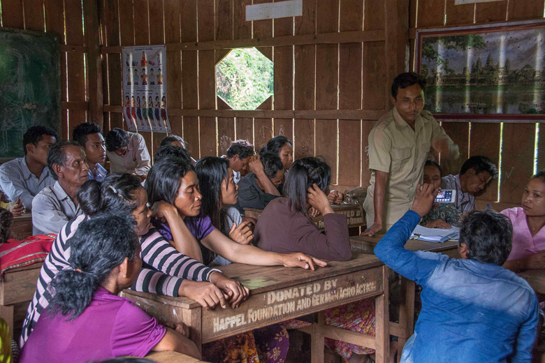Ven Vorn, an indigenous Chong activist from Chumnoeb community in Cambodia's Areng Valley, addresses provincial officials and villagers at a meeting in May 2014 to discuss how the now-shelved Areng dam would affect the community. Vorn was arrested and jailed in Koh Kong city in October. Photo by Rod Harbinson.