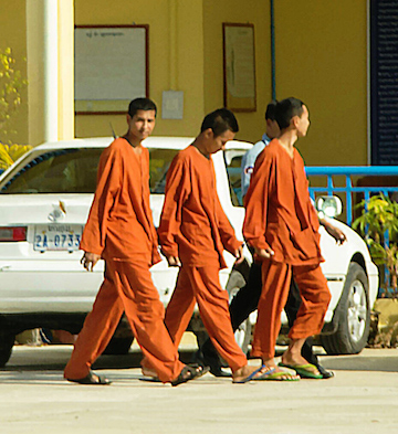 Left to right: Sim Somnang, Try Sovikea, and San Mala are photographed for the first time since their arrest walking into Koh Kong provincial court for pre-trial questioning on November 4 in Koh Kong City. Photo by Mot Kimry/Mother Nature Cambodia.
