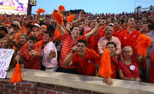 Clemson tiger fans cheering, by Paul Zoeller