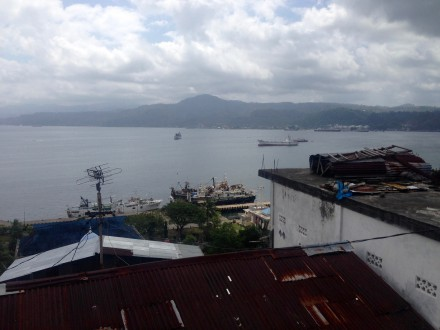Moored trawlers in Ambon Bay can be seen from Ani Imbran's house. Photo by Cory Rogers