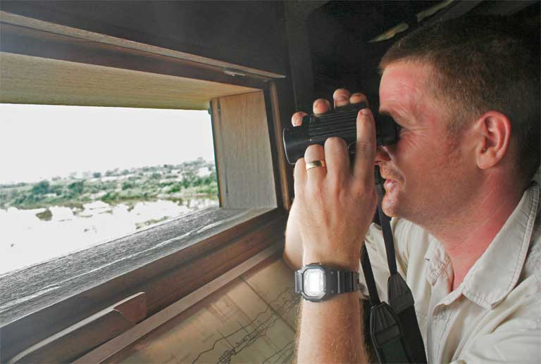 Reserve Manager Bena Smith looks out from one of many bird blinds at Mai Po. Photo by Doug Meigs