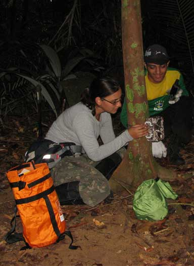 Maíra Benchimol with a field assistant deploying a camera trap on a surveyed island. Photo by Maíra Benchimol