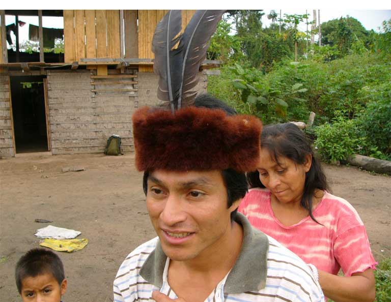 Native community member with a yellow-tailed woolly monkey (Oreonax flavicauda) skin/pelt as headdress. Photo by Anne DeLuycker
