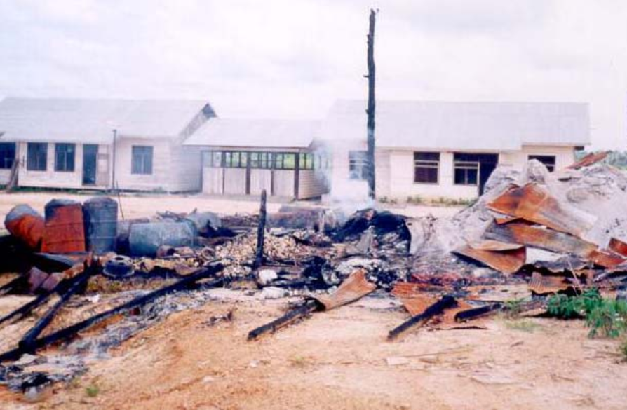 London Sumatra's burned out base camp in the 1990s. Photo courtesy of Telapak