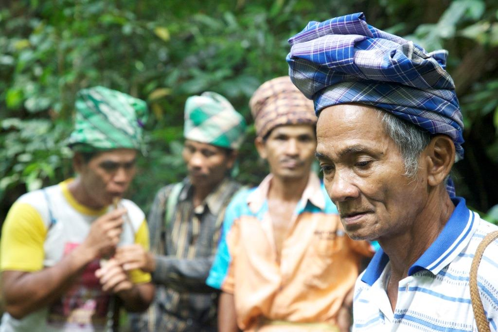 Muara Tae elders including Andreas Singko (front) perform a ritual in 2012. Photo by Tomasz Johnson/Environmental Investigation Agency