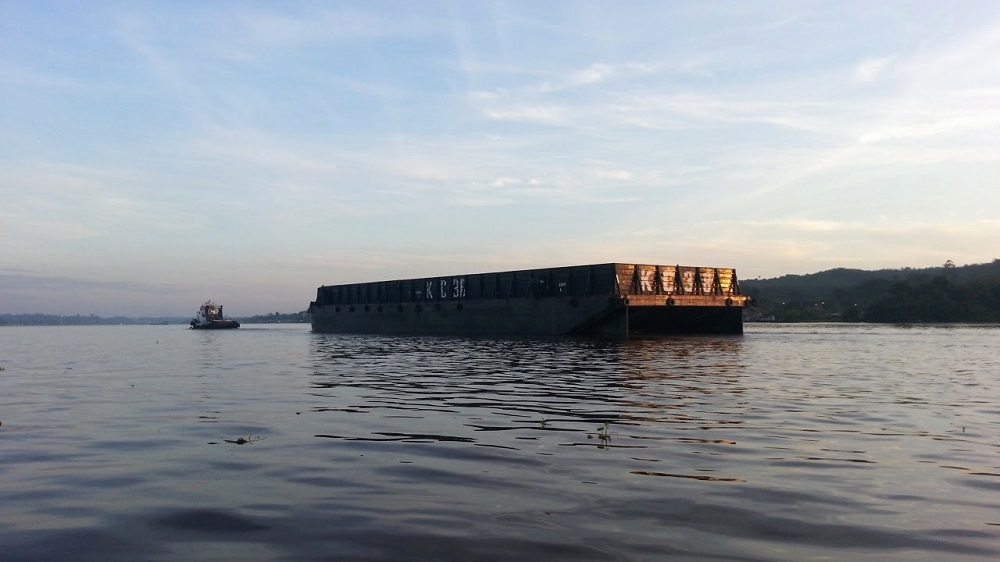 A coal barge makes its way down the Mahakam. Photo by Philip Jacobson