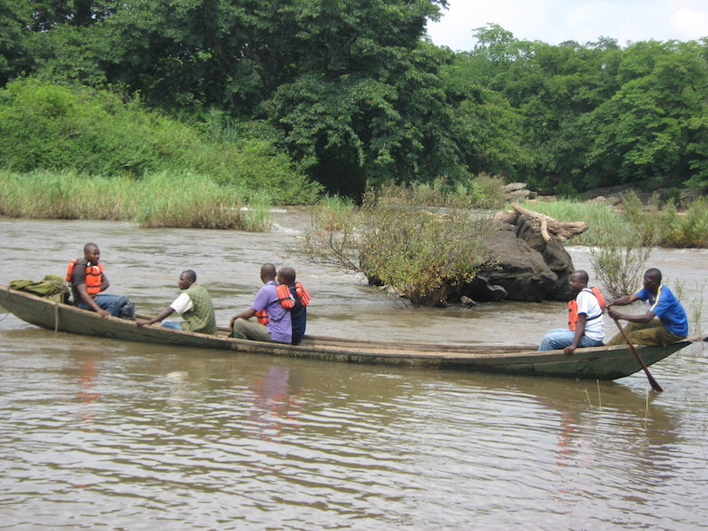 Park rangers cross the River Kam in a traditional dugout canoe while making their patrol rounds. Photo by Lawal Sani Kona.