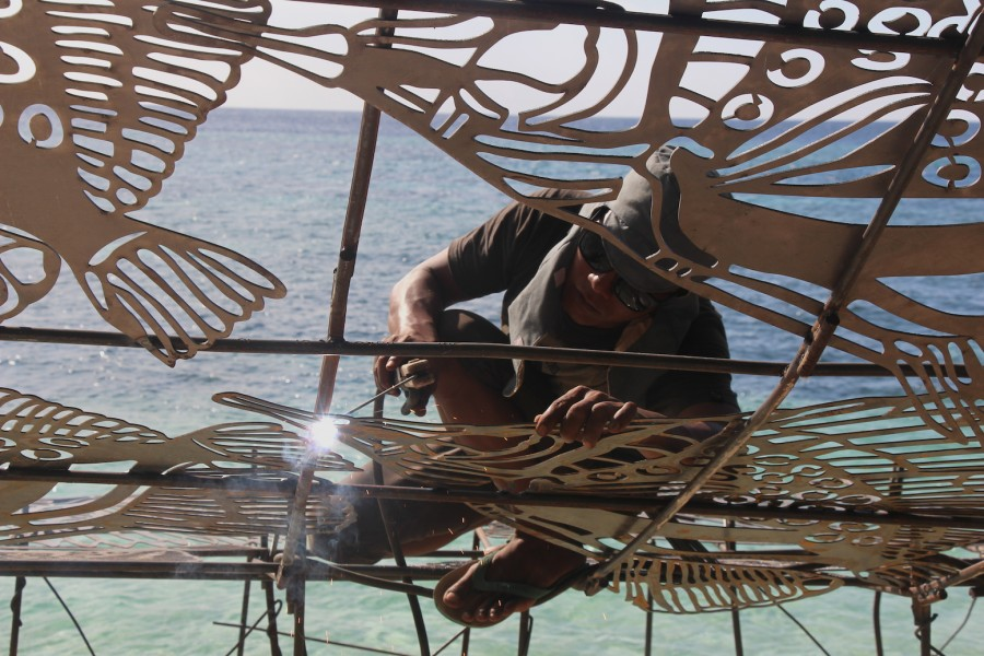 A worker welds together the ARTificial reef in Wakatobi ahead of Coral Day in Southeast Sulawesi. Photo by Melati Kaye
