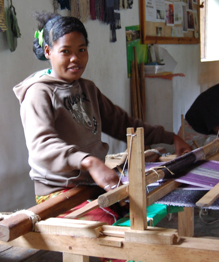 A young weaver with the Famiova Weaving Cooperative. Photo by Jan Gogarten.