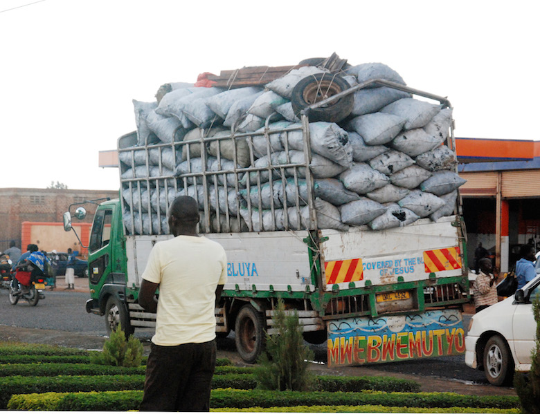 A truck loaded with charcoal heads to Uganda's capital city of Kampala from Lalogi sub-county. Photo by Arnest Tumwesige.