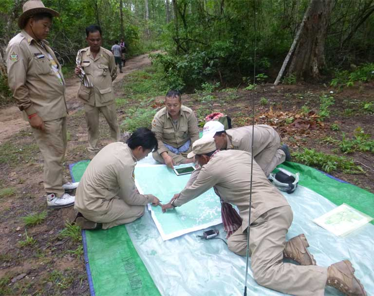 Rangers plan their patrols in Preah Vihear Protected Forest, home to the endangered Pileated Gibbon. Photo courtesy of Alistair Mould (WCS).