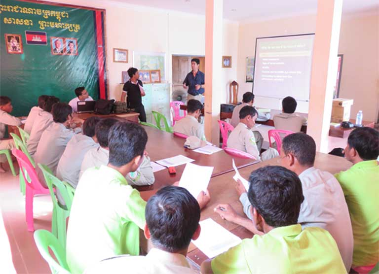 SMART (Spatial Monitoring And Reporting Tool) training course run by WCS. The WCS's Northern Plains Pileated Gibbon Project uses a combination of technology and community engagement to help conserve the species. SMART is a new approach, combining technology and capacity building to improve law enforcement patrols. Photo courtesy of Alistair Mould (WCS).