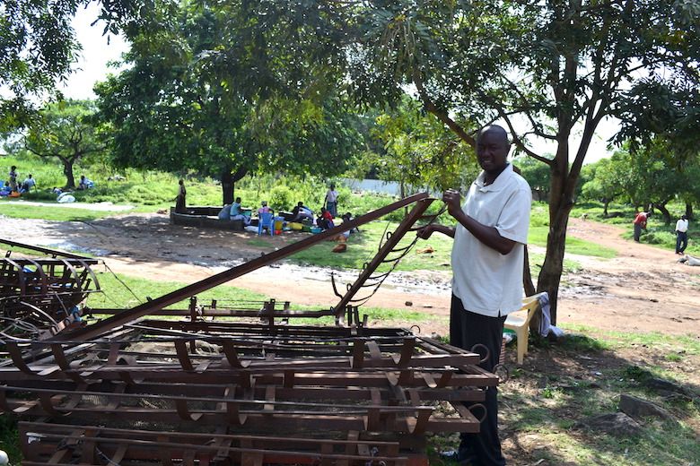 Paul Ochieng Okuta of the Dunga Beach Management Unit, a fishermen's cooperative, displays some of the materials his group uses to construct floating cages for aquaculture. Photo by Isaiah Esipisu.