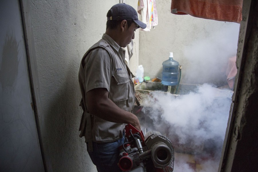 Health Ministry workers participate in a day of spraying in the Bethania colony zone 7 of the capital city of Guatemala to combat the mosquito Aedes aegypti, which is the transmitter of the virus vector zika, dengue and chikungunya. Photo Credit: Conred Guatemala / Flickr.com.