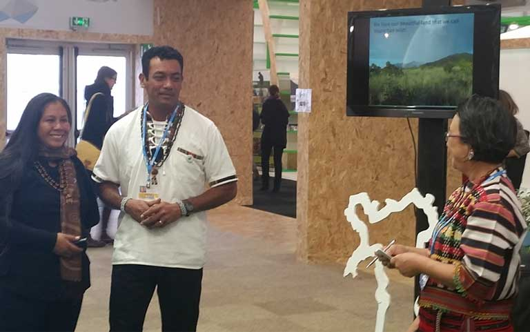 3)Nicholas Fredericks makes a presentation highlighting Wapichan community-led forest management at COP21. The Wapichan live in the Amazon rainforest of Guyana. Photo by Mitch Paquette.